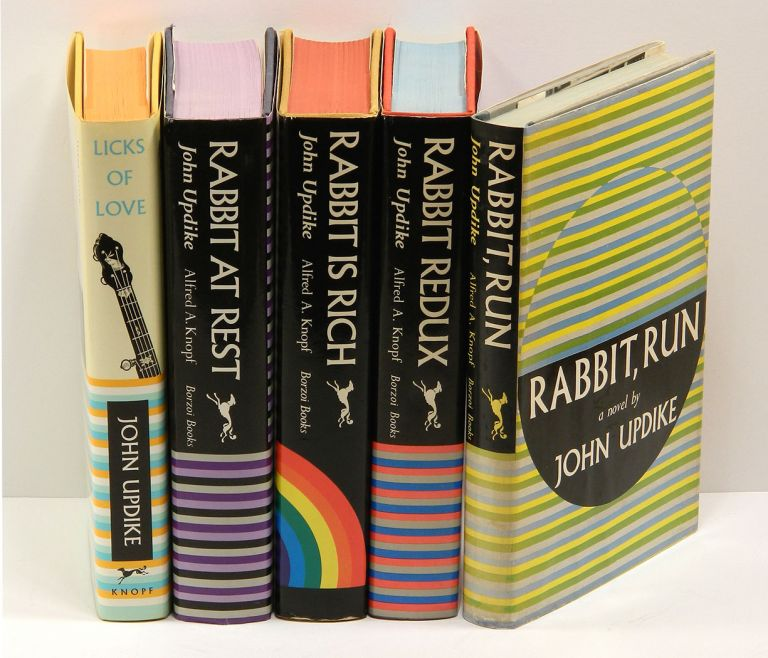 """EACH WITH A CARD SIGNED BY UPDIKE LAID IN: RABBIT, RUN (1960); RABBIT REDUX (1971); RABBIT IS RICH (1981); RABBIT AT REST (1990); and the novella """"Rabbit Remembered"""" in LICKS OF LOVE (2000). John Updike."""