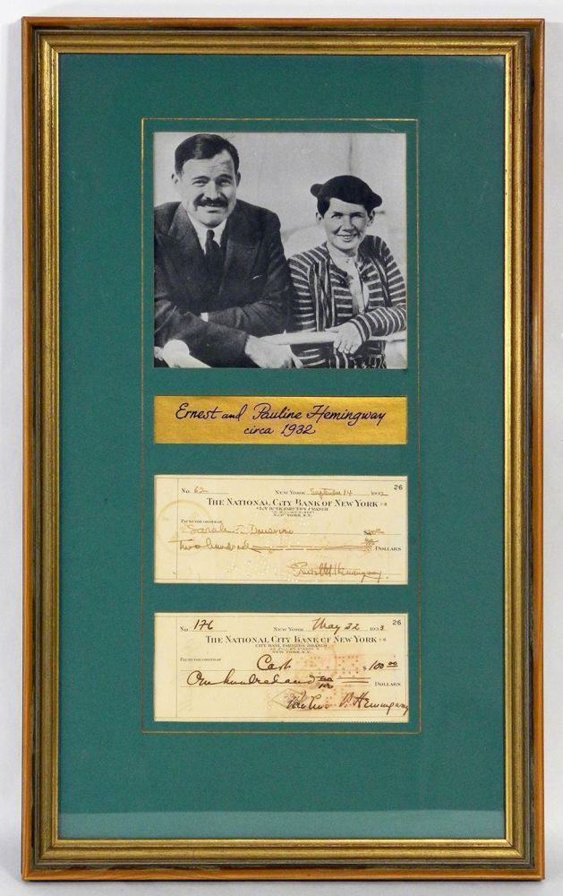 TWO SIGNED CHECKS: ONE SIGNED BY ERNEST, THE OTHER BY PAULINE: MATTED AND FRAMED TOGETHER WITH A PHOTOGRAPH. Ernest Hemingway, Pauline.
